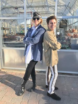 Julie Jo Fehrle and Maxfield Y Rhine in front of the Mainescape greenhouse, the site of a planned fashion show on March 29. Photo courtesy of Julie Jo Fehrle